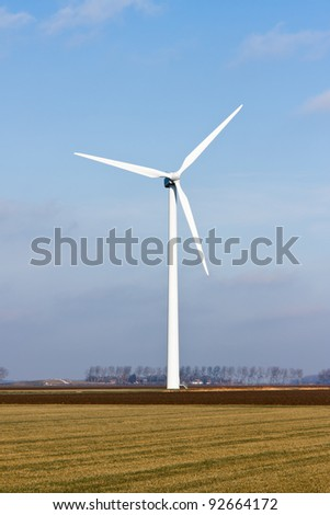 Wind turbine in the farmland of Flevoland, the Netherlands