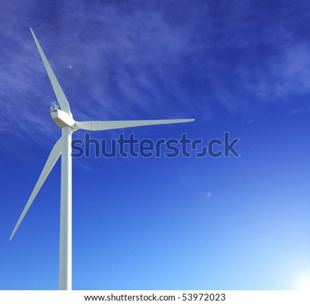 wind turbine iwith blue sky as background