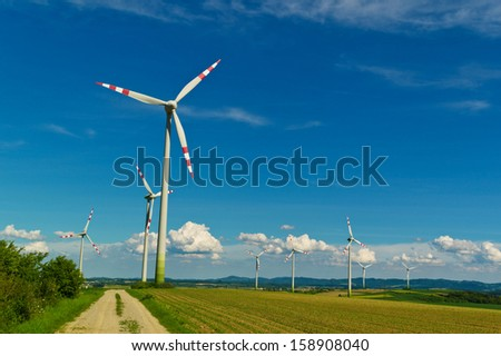 wind turbine of a wind power plant. production of alternative and sustainable energy for power generation - stock photo