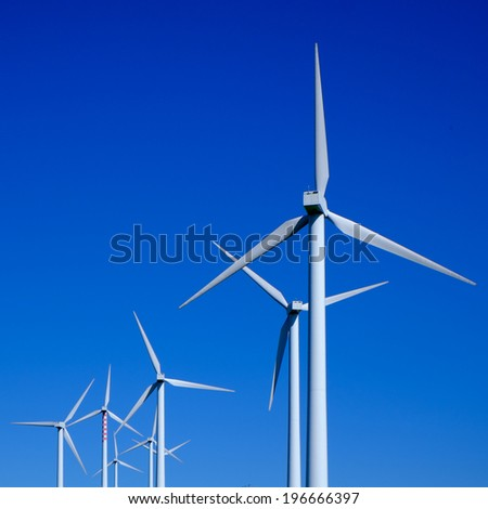 Wind turbine on a blue sky