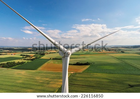 Wind turbine on a field, aerial photo - stock photo