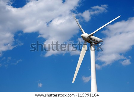 Wind turbine on a field, close up - stock photo