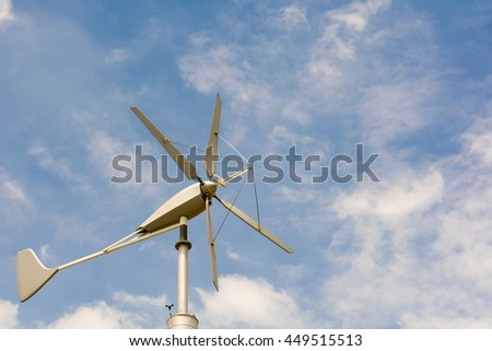 Wind turbine on blue sky , copy space.
