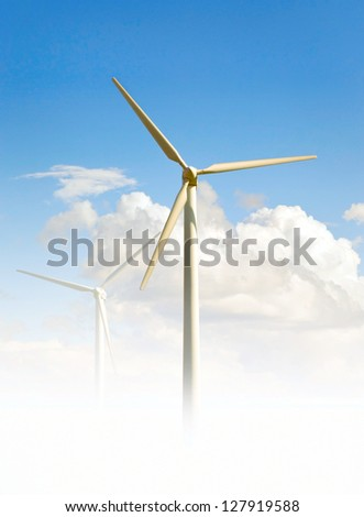 Wind turbine on bright blue sky, producing clean energy