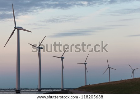 Wind turbine park in the Dutch Markermeer lake during sunset