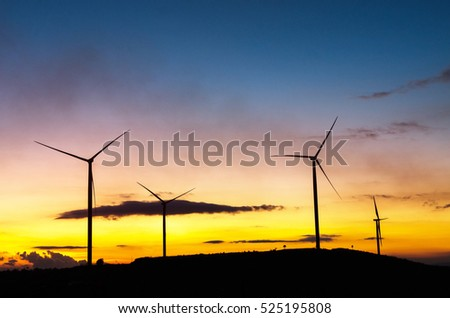 Wind turbine power generator at cloudy sky and sunset, alternative energy resources