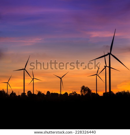 Wind turbine power generator at twilight