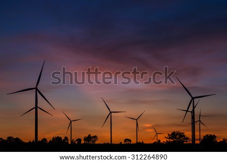 Wind turbine power generator at twilight in Thailand