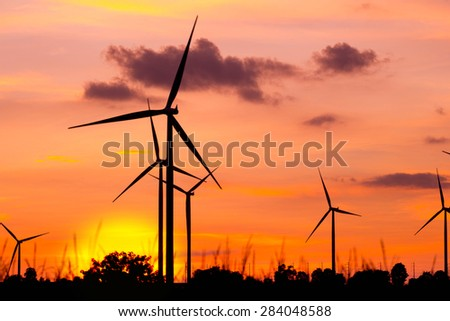 Wind turbine power generator at twilight sunset