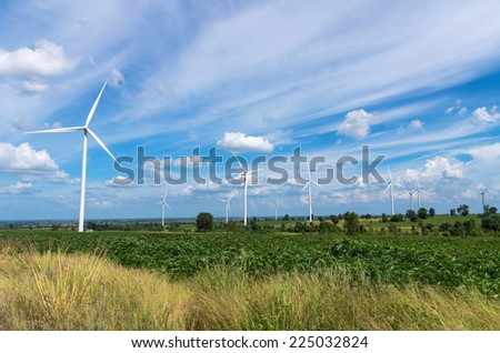 Wind turbine power generator on blue sky