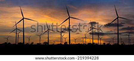 Wind turbine power generator with panorama at twilight time  - stock photo