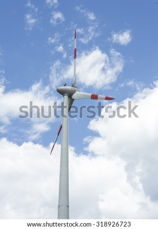 Wind turbine producing energy in the sky.