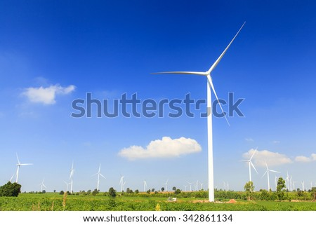 Wind turbine renewable energy source summer landscape with blue sky - stock photo