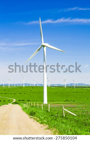 wind turbine,road and meadow under blue sky