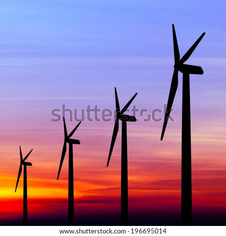 wind turbine silhouette on colorful sunset abstract for green earth concept - stock photo