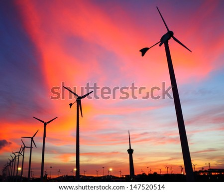 Wind turbine silhouettes at twilight, at Thailand