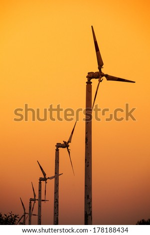 wind turbine sunset background - stock photo