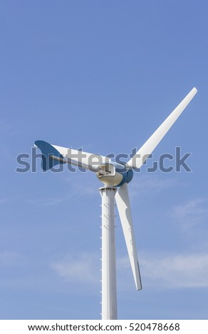 Wind turbine the Natural Energy with blue sky background.