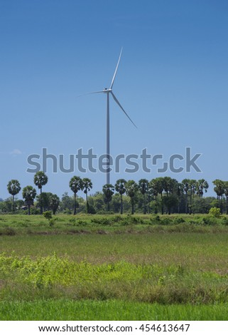 Wind Turbine to produce energy from wind and the blue sky in Thailand