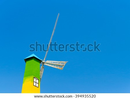 Wind turbine tower on blue sky background, Copy Space - stock photo