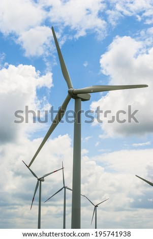 Wind turbine (wind power plant) - a device for converting the kinetic energy of wind into electrical energy. - stock photo