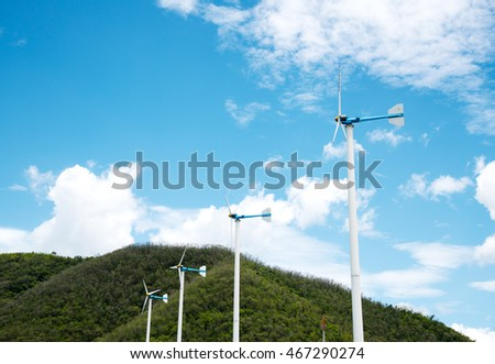 Wind turbine with blue sky and mountain