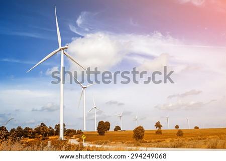 Wind turbine with blue sky, renewable energy - stock photo