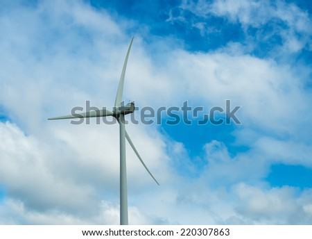 Wind turbine with the background of cloudy sky
