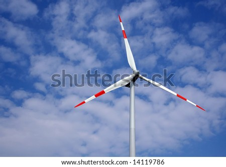 Wind turbine with white blades - stock photo