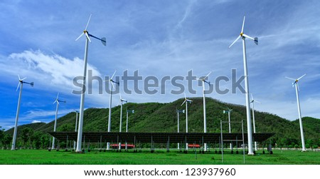 Wind turbines and blue sky - stock photo
