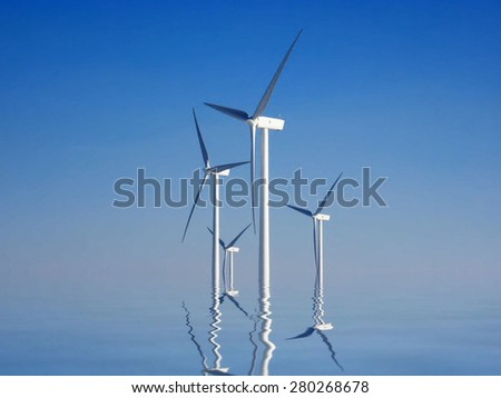 wind turbines and reflection in the water - stock photo