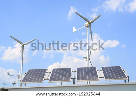 Wind turbines and solar panels.
