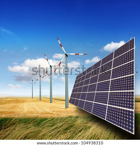 Wind turbines and solar panels generate electricity - stock photo