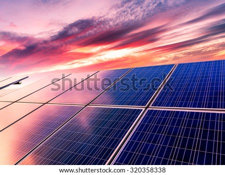 Wind turbines and solar panels. Green energy - stock photo
