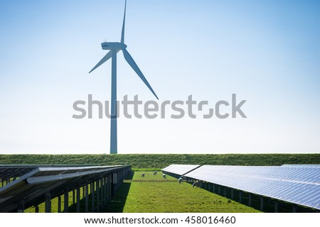 Wind Turbines and solar panels on the meadow in the North Sea region, Germany