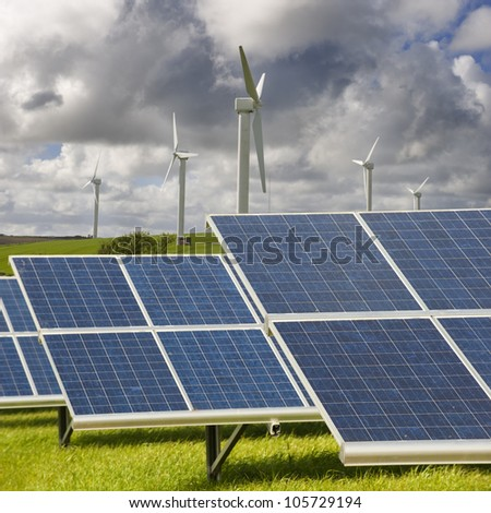 Wind turbines and solar panels. These are in Cornwall in the UK. - stock photo