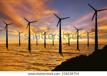 Wind turbines and sunset in the sea