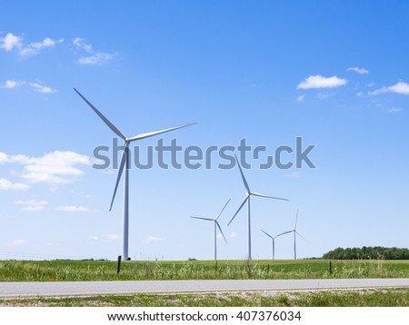 Wind turbines at a wind farm in rural southern Ontario Canada. - stock photo
