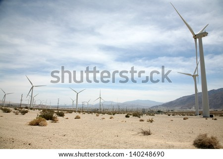 Wind Turbines at a Wind Farm in Southern California by Palm Springs produce Green Energy and help to power the homes and businesses of Palm Springs, Palm Desert, and surrounding cities.  - stock photo