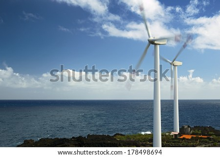 Wind turbines at the sea - stock photo