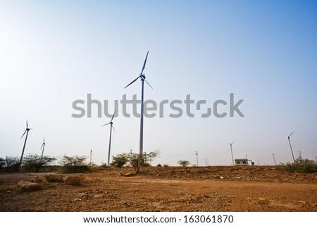 Wind turbines at wind farm, Jaisalmer, Rajasthan, India - stock photo