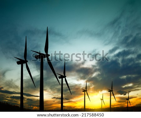 Wind turbines during amazing sunset