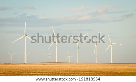 Wind turbines farm at sunset in Limon, Colorado.
