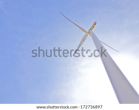 Wind turbines generating electricity, green energy concept