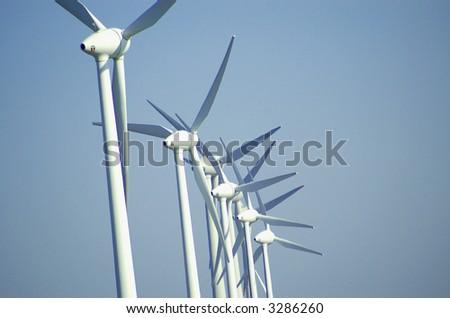 Wind turbines in a row - stock photo