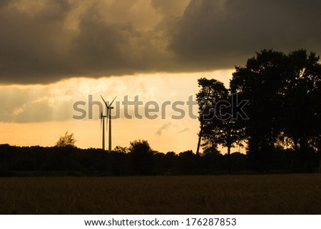 wind turbines in a stormy atmosphere