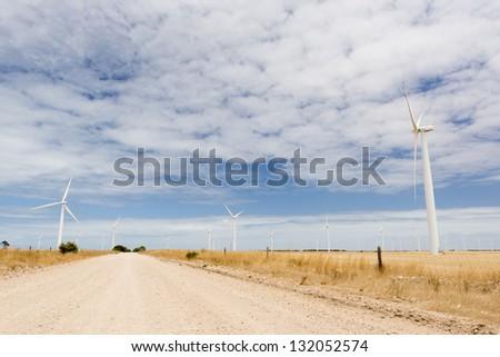 Wind turbines in a wind farm in rural Australia - stock photo