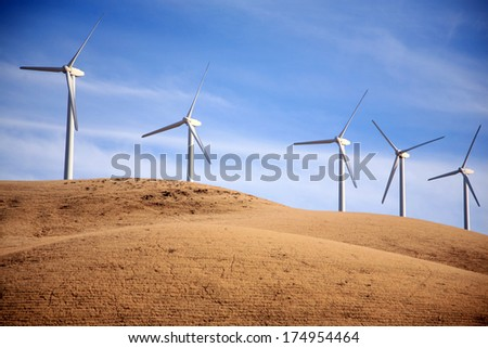 Wind Turbines in Central California produce electricity with the power of the wind. Wind Power is a Green Energy source which helps reduce Global Warming by harnessing the power of the wind.  - stock photo
