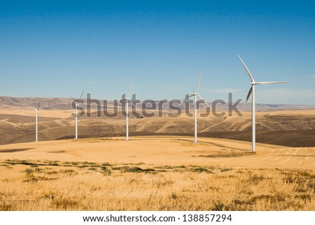 Wind turbines in Columbia gorge with blue sky - stock photo