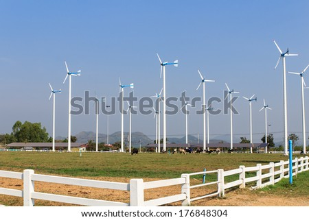 Wind turbines in farm with blue sky background - stock photo